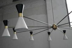 View this item and discover similar for sale at - Huge Italian Stilux Chandelier circa Black and off white aluminium shades, brass centre ball, brass tubes and details. Chandelier Pendant Lights, Modern Chandelier, Chandeliers, Ceiling Fan, Ceiling Lights, Unique Lamps, Floor Lamp, Antiques, 1950s