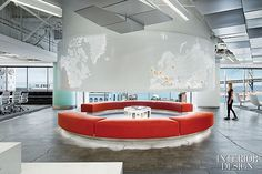 In office reception, custom benches upholstered in recycled polyester form an arena for sharing ideas