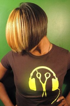 a sweet BOB haircut with bold blonde panels in the Fringe. Relaxer -free hair. www.rhythmhairstudio.com