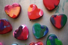 melted crayons...take your old broken crayons put them in a baking mold of your choice. (remove paper with warm water it comes right off)     Bake the crayons at 230 degrees for 15 minutes.    Pull the melted crayon hearts out and let them cool. When they have completely cooled, pop them out.
