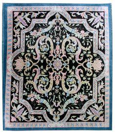 An artistic Savonnerie carpet, the black field having a pastel curvilinear…