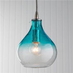 Teardrop Glass Pendant - Aqua Ombre Seeded glass in a teardrop shape fades from clear to color (or just clear if subtle glisten is what you desire) for an ombre effect with just enough color to pop in your space. Satin Nickel hardware and a silver mesh covered cord.  40 watts. (medium base socket) (9Hx7W) 8 cord 5 canopy  Product SKU: PE12050 AQ Price:  $199.00