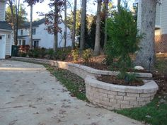 We built a nice retaining wall that doubles as a planter along a driveway to…