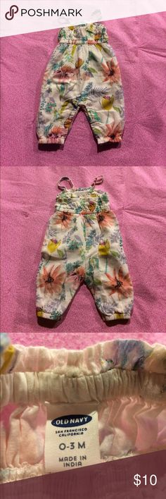 Adorable Old Navy romper This super cute romper has never been worn. Size 0-3 months and 100% cotton. Covered with beautiful flowers it's sure to get some compliments!! 💕 Old Navy One Pieces