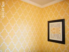 White Marrakech Trellis Allover Stencil on yellow walls. I'm thinking metalic stencil on one grey focus wall.