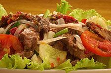 Beef Salad :Lettuce with grilled beef, onions, cucumbers, tomatoes and spiced with lime juice from Mint Garden Thai Cuisine Restaurant in Blvd, Los Angeles #Food #Salad forked.com