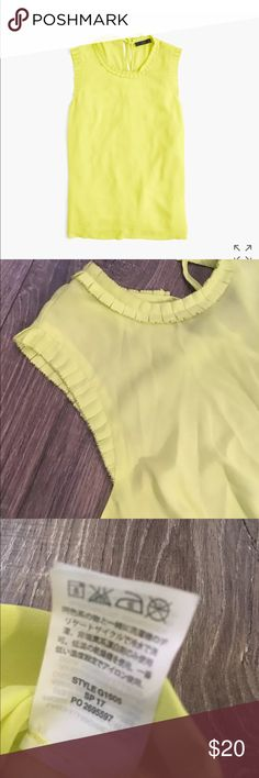 J. Crew sleeveless drapey ruffle trim blouse PRODUCT DETAILS The top that instantly pulls together any outfit, thanks to its drapey, silk-like fabric and ruffly trim. Size 8 Sleeveless  Tie rear keyhole Poly.Machine wash.Import. Item G1505. J. Crew Tops Blouses