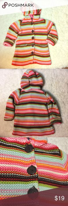 Baby gap snuggly sweater jacket with buttons Cozy & colorful knit sweater jacket. Baby Gap 18-24 months. EUC. Last pics shows a snag, virtually invisible from the outside, but visible on the inside of the garment. Priced accordingly. 🚫NO TRADES GAP Jackets & Coats