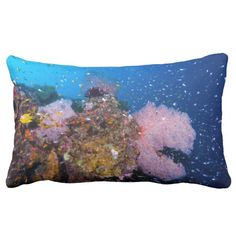 A throw pillow that feature the abundant schools of colorful tropical fish playing around 3 huge coral fans on Australia's Great Barrier Reef in the Coral Sea.