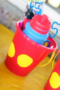 DIY Mickey Mouse Party Bucket Favors  For Kealeys 6th and Jaxons 2nd together Minnie and Mickey birthday party!