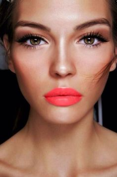 A coral lip paired with bronze eyeshadow is a red hot look for summer.