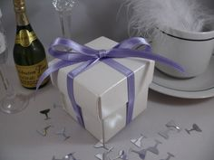 White square box with lid decorated with lilac satin ribbon, simple but elegant x