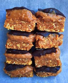 Chocolate Caramel Slices - The base is basically rolled oats, nuts, coconut flakes, dates. The caramel : dates, cashew nut butter (or your fave nut butter), coconut nectar, sea salt flakes. The chocolate : melted dark chocolate! 👅  Blend each layer separately in a food processor, press into a square tin, then refrigerate overnight.