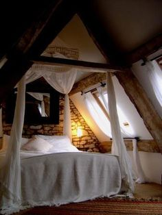 Cozy attic bedroom.  I've always loved finished attics... love the ceiling lines and cozy feeling.