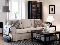 EKTORP three-seat sofa with Tygelsjö beige cover and HEMNES black-brown coffee and side tables