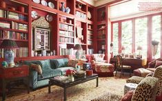Vivid lacquer paint in a custom mix sets off an eclectic display of books and antique porcelain. Custom sofa and slipper chairs in Clarence House, antique Oushak rug - Beverly Field design Clarence House, Casas Texas, Veranda Magazine, Custom Sofa, Home Libraries, Red Rooms, Texas Homes, Library Design, Decoration