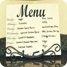 stephs menu board is a smooth tile supported by a pretty easel with some vinyl lettering on it.