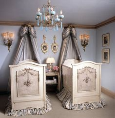 I love the dueling cribs.  This country style is too much for me, but I like the basic idea.  The canopies above the cribs are awesome and would be fabulous in a more flirtatious style.  PS- I heard twins like to sleep together or else they cry.