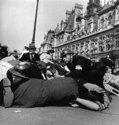 Paris. August 26th, 1944, German Snipers open fire on the celebrations after the liberation. Image by Robert Capa
