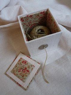 Une boîte à ficelle