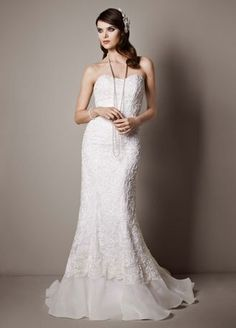 This lace-over-charmeuse trumpet gown balances glamour with timeless beauty. Lace-over-charmeuse is ultra feminine and so chic, and the beaded soutache floral detail adds rich texture. Bridal Lace, Bridal Gowns, Wedding Gowns, Bridal Style, Fall Wedding, Dream Wedding, Wedding Gown Preservation, Trumpet Gown, White Gowns