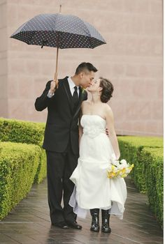 matching umbrella and rain boots...what a way to rock a rainy day wedding.