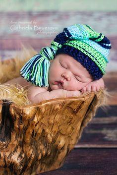 Newborn baby with Image of Boy Tassel Hat in the bucket 5ff9487c3190