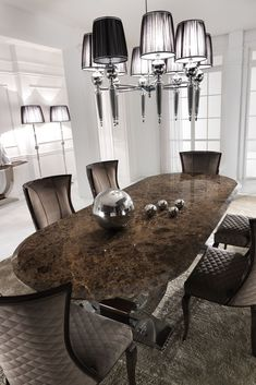 The beautiful brown tones of this superb emperor marble table are complemented perfectly and supported by two striking polished stainless steel u shaped plinth style bases with feature antique bronze detailing. The Luxury Italian Brown Marble Oval Dining Set offers outstanding style and comfort, providing the ultimate sophisticated dining experience!