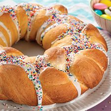 Easter Bread Wreath: King Arthur Flour -This bread is a not-too-sweet, orange-scented rendition of Italian Easter bread. We've chosen to braid it, form it into a ring, and top it with colorful sprinkles; but feel free to embellish and decorate it however you'd like.