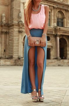 Pink top and a blue high low skirt.