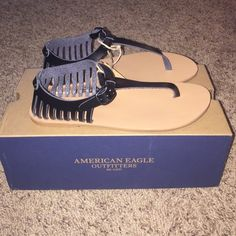 NIB American Eagle Outfitters Sandals 7 These sandals are super cute and black in color. Retails for $29.95. NOT NEGOTIABLE ON PRICE AND NO TRADES  Listed for less on Merc! Also available in tan. American Eagle Outfitters Shoes