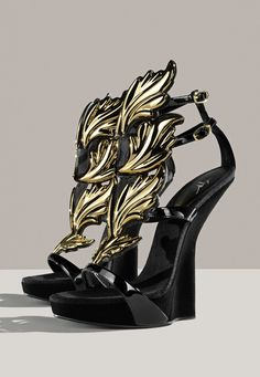 GIUSEPPE ZANOTTI: Gold leaf details take these wedge gladiators to entirely new heights.