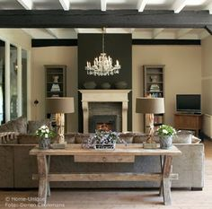 neutral chic gorgeous living room rooms design chandelier sofa chairs pillows coffee table cathedral ceiling beams modern | Froghill Designs...