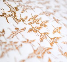 Handmade origami paper  Golden cranes on white