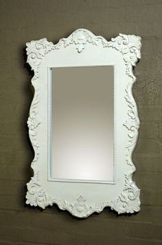 another white framed mirror