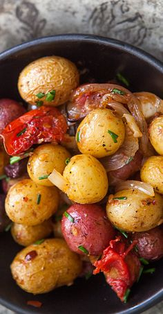 Provencal New Potatoes! Small new potatoes, roasted with onions, garlic, tomatoes, olives, and herbes de Provence. On SimplyRecipes.com #vegan