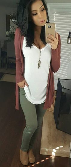 Love the olive green pants paired with the rose cardigan.