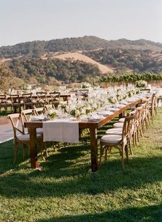 Wood tables with linen runners and small centerpieces