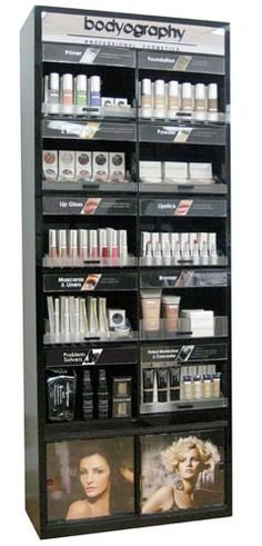 HERE AT TRUBEAUTY!!!      Bodyography's consumer friendly Self-Service Display is a beautiful eye catching addition to any store or salon. Featuring 18 makeup categories and 60 products that cover every angle of beauty, from bridal, to creative and everything in between. This fabulous acrylic display comes with 1 tester and 6 retail of each product across every category.
