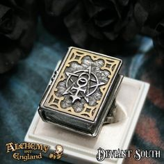 Last Chance! Alchemy Gothic AG-R187 Dee's Book Of Angel Magic Stash Ring  A pewter book-style stash ring, with brass inlay cover and hinges, a magnetic catch and on a forked shank.