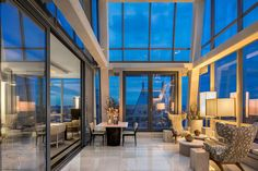 An Outdoor Balcony Sits Off The Glass Enclosed Solarium Of A Duplex In Tower One57