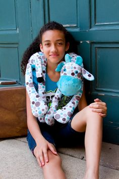 This Blue Cow is a plush neck pillow for travel by mynuzzyhouse