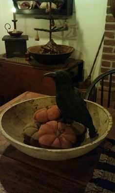 Prim Fall...with a crow & pumpkins in an old wooden bowl.