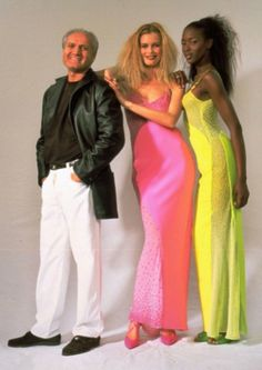 Italian fashion designer Gianni Versace, left, poses with German model Claudia Schiffer,center and British model Naomi Campbell March 12,1996 in Milan, Italy, during fashion week. Claudia Schiffer sports a fushia silk crepe long dress while Naomi Campbell sports a yellow silk crepe long dress, both from Versace designer.