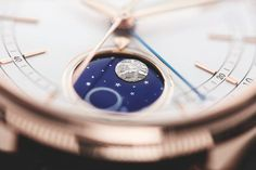 The @rolex Cellini Moonphase - its white lacquered dial opens up at the 6 o'clock position to reveal a blue enameled disk displaying the full moon, the new moon, and a field of stars.  More @ http://www.watchtime.com/wristwatch-industry-news/watches/rolex
