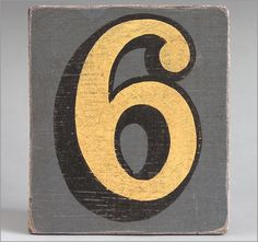 Hand-painted grey wooden number sign: '6'