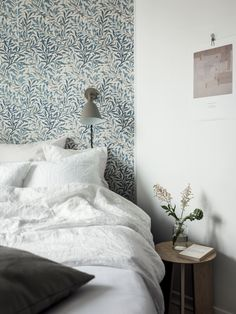 Let delicately detailed wallpaper make a statement with beautiful, simple linens and furniture.