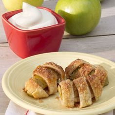 Bite-Size Apple Pies Recipe. Pastry strips simply wrapped around apple wedges, sprinkled with cinnamon-sugar, and baked.