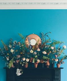 We want this #DIY floral mantel display — and this wall color.