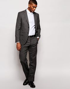 "Suit trousers by DKNY Soft-touch wool Zip fly with hook and bar fastening Side pockets and two back pockets Slim fit - cut closely to the body Dry clean 100% Wool Our model wears a 32""/81 cm regular and is 188cm/6'2"" tall Garment comes unhemmed Designed to be tailored to desired length"